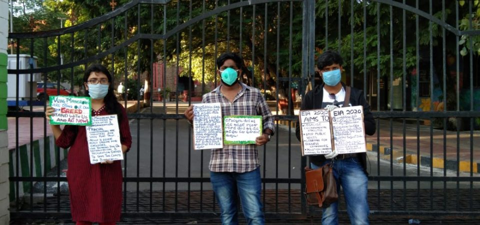 three people protesting in Vizag against the EIA 2020.